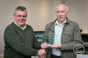 Derry Leonard accepts the Fisherman of the Year award on behalf of his son Dermot.