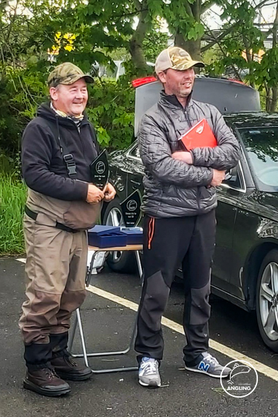 Martin Fagan presented with the trophy for heaviest fish 2020 by Tommy Keoghan. Trim Athboy Anglin Association.
