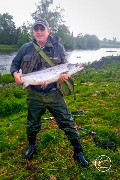 Pat Gartland with a salmon caught on a mayfly on the River Boyne, Trim, Co. Meath.